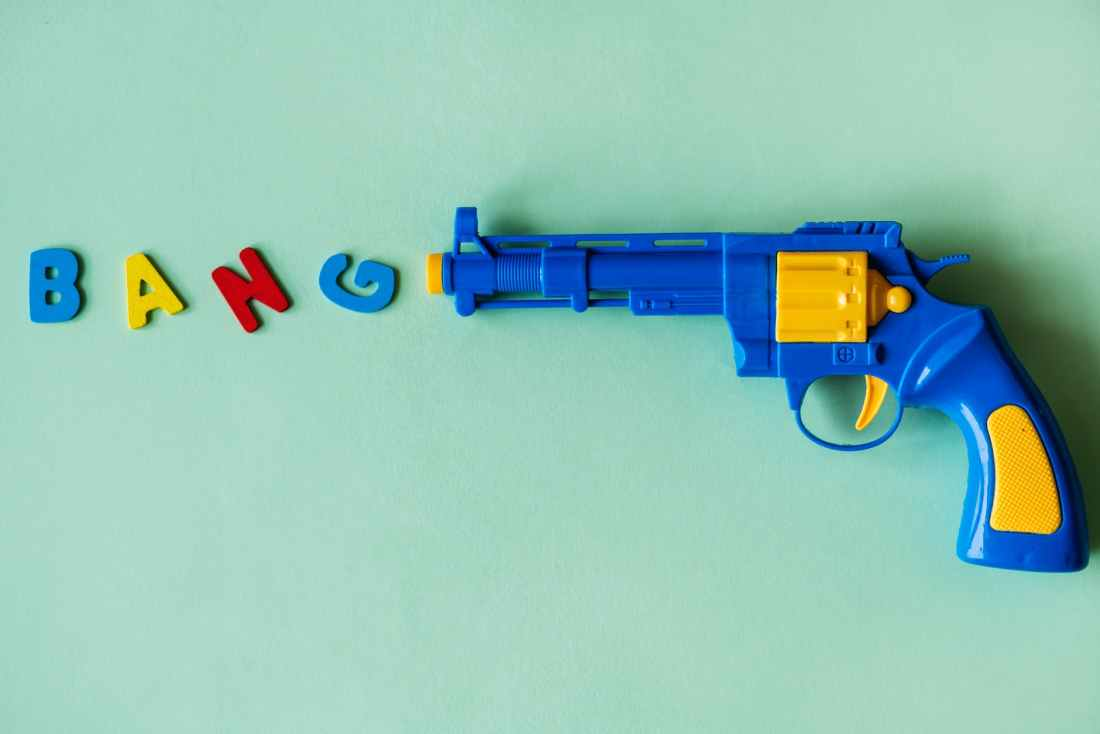 blue and yellow plastic toy revolver pistol